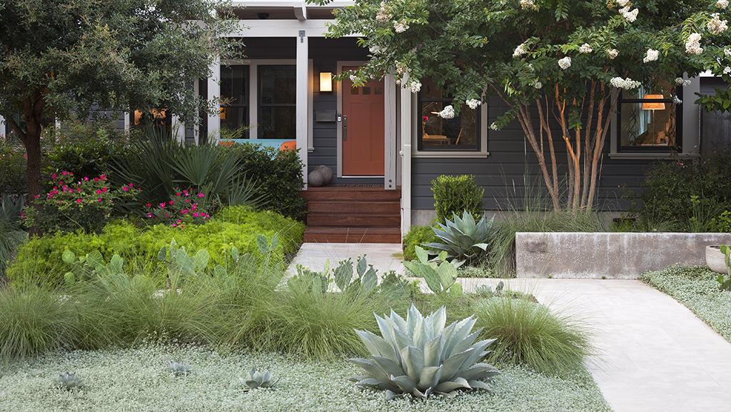 blue house with orange door and front garden