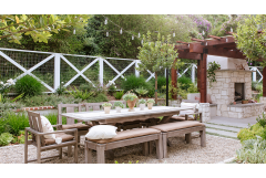 wood dining room table with award-winning landscaped garden